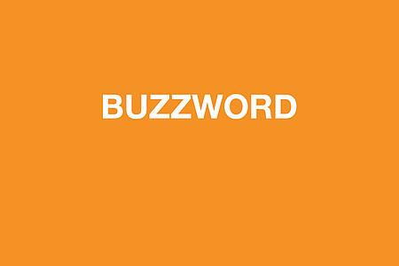 Der Text Buzzword auf orangenem Grund