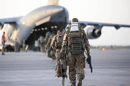 Bundeswehr-Soldaten beim Abzug aus Afghanistan. Was bleibt nach 20 Jahren Militäreinsatz?. Foto: Torsten Kraatz/Bundeswehr/dpa