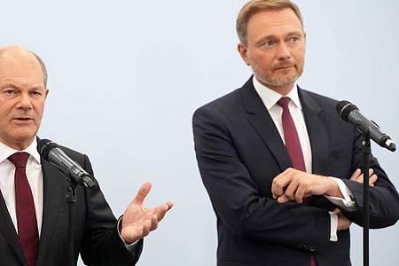 Der mögliche neue Kanzler Olaf Scholz (l) - und sein künftiger Finanzminister und Amtsnachfolger Christian Lindner?. Foto: Kay Nietfeld/dpa