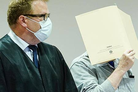 Der Angeklagte Anfang September im Landgericht Heidelberg. Foto: Uwe Anspach/dpa pool/dpa