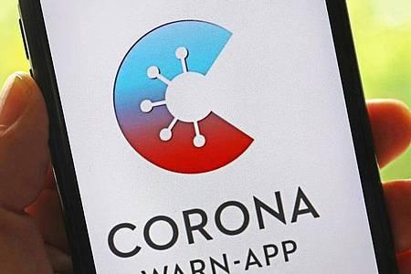 Die offizielle Corona-Warn-App wurde laut RKI bislang 33,1 Millionen Mal heruntergeladen. Foto: Oliver Berg/dpa